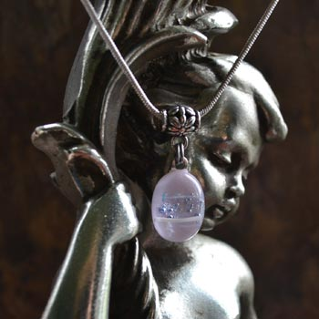 jewelart jewellery photography using a cherub prop