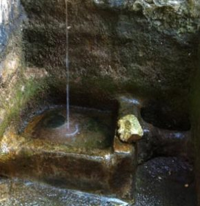 white spring water at glastonbury tor