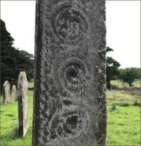 spiral decoration on a stone cross in Cumbria
